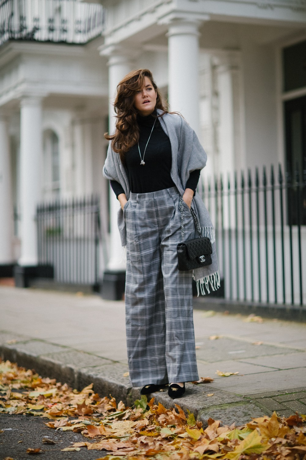 High waisted trousers and a black polo