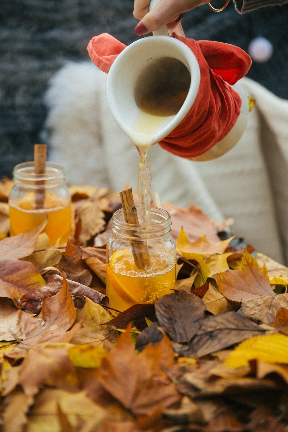 Mulled cider and autumn leaves