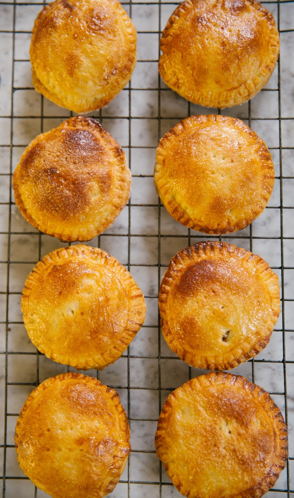 Individual apple pies, fresh from the oven