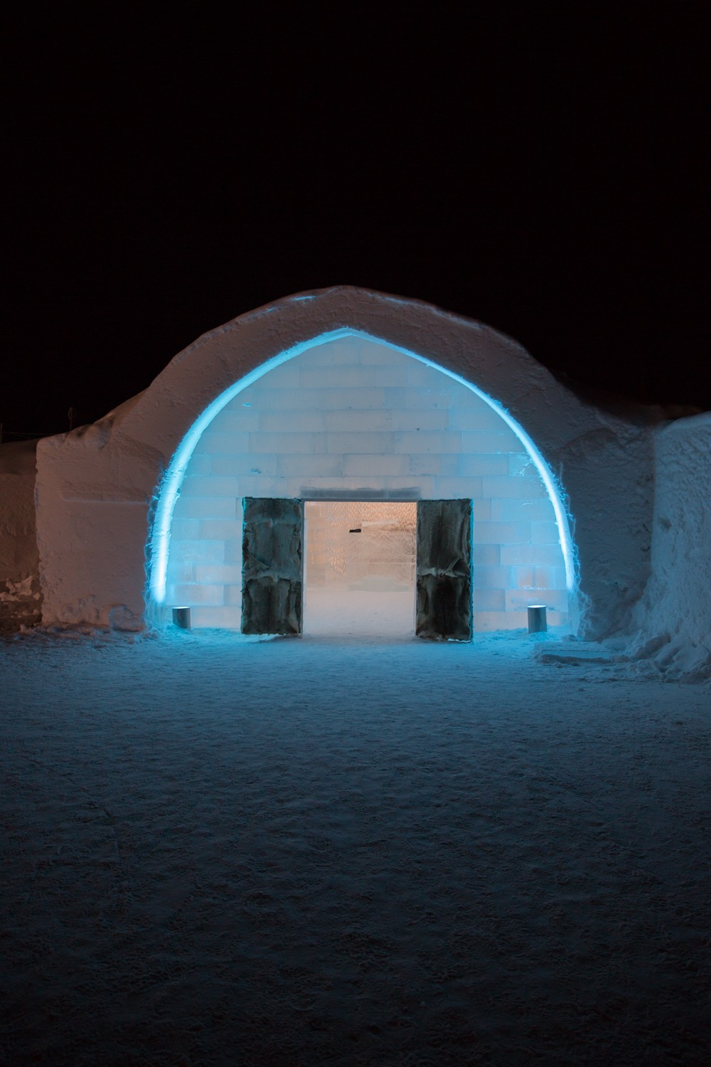 Glowing entrance to The Ice Hotel