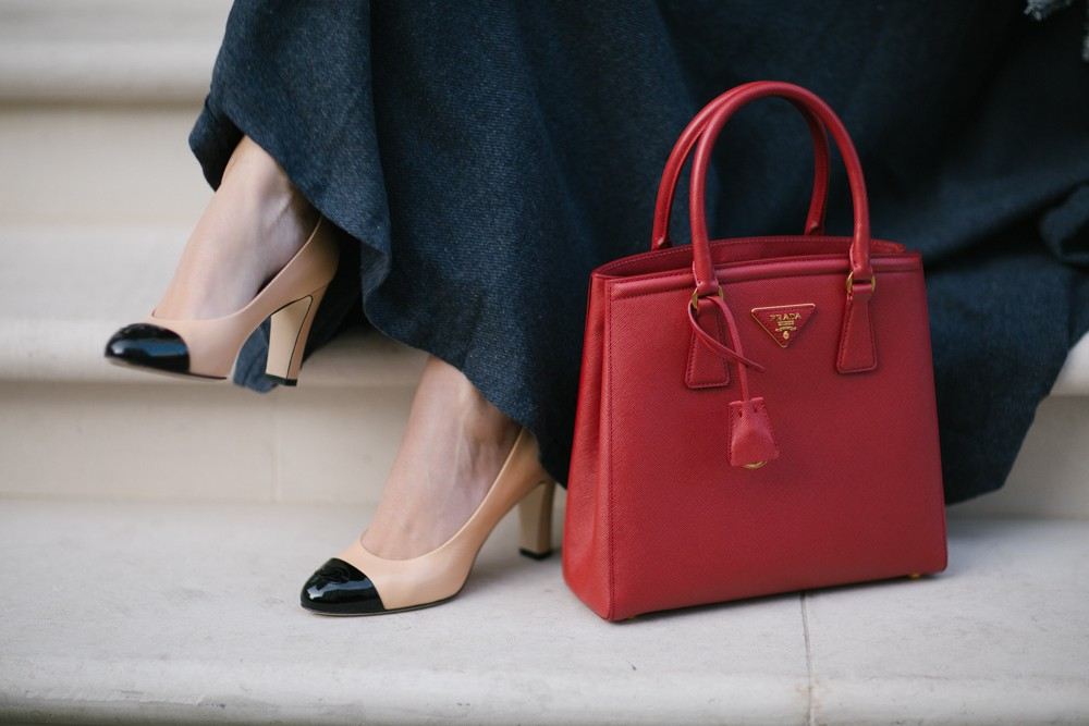 Chanel pumps and Prada tote