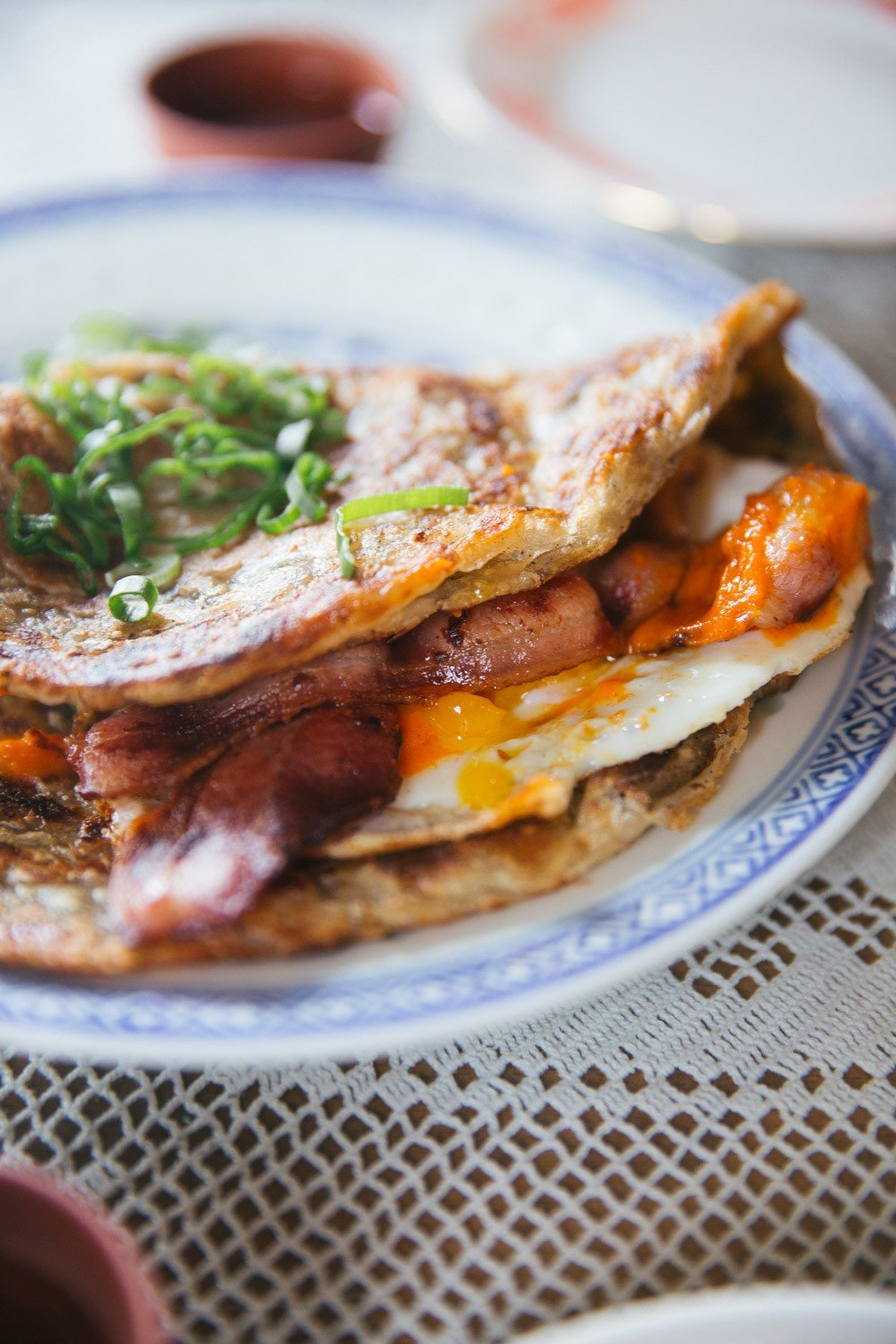 Scallion pancake stuffed with bacon and egg
