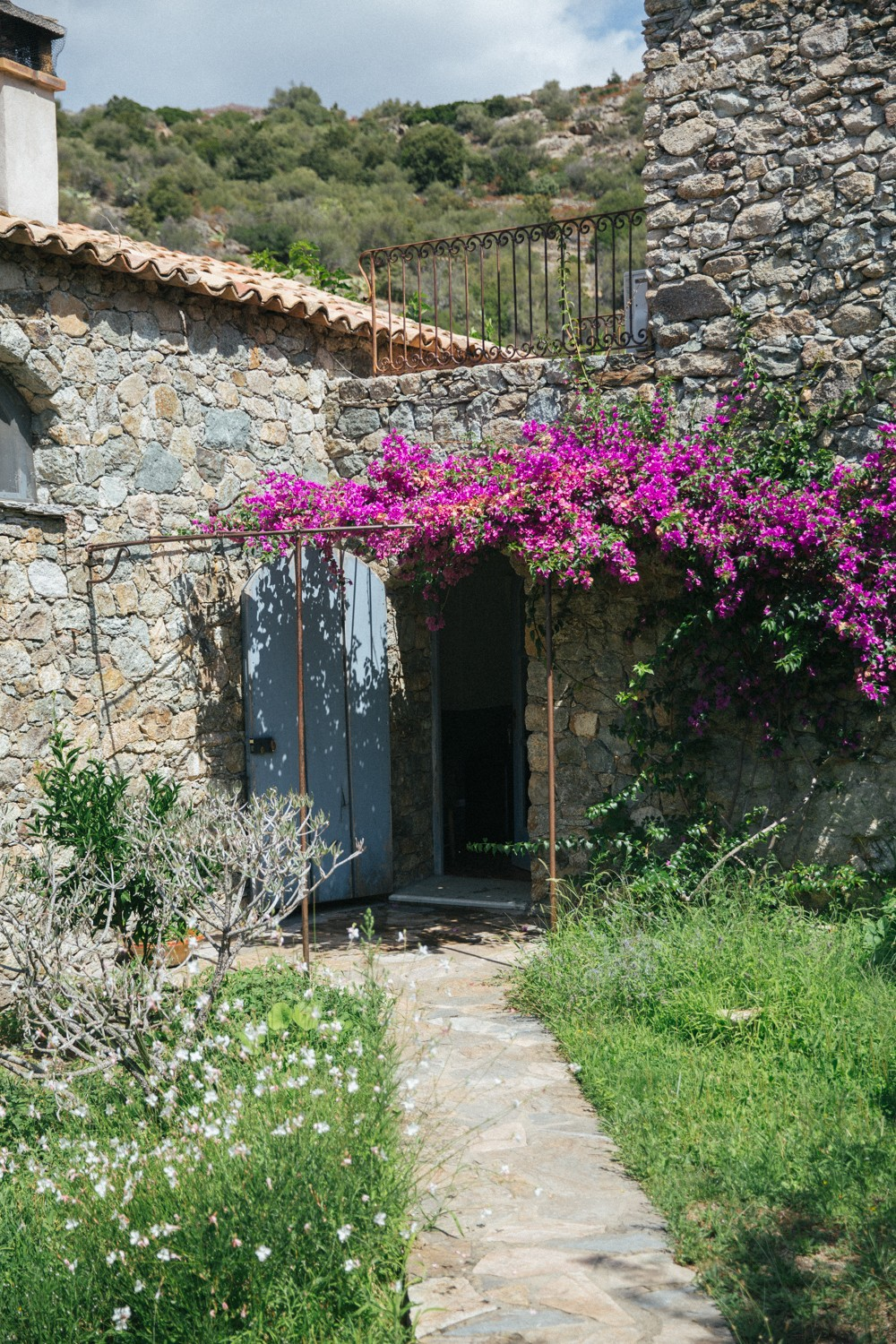 Stone cottage with bouganvilla
